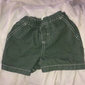 Olive green shorts white stitch
